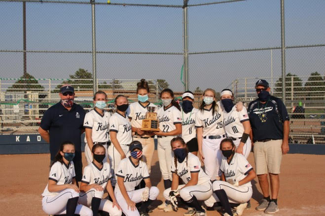 The+girls+Air+Academy+varsity+softball+team+proudly+presents+their+newly+gifted+award.+Despite+the+players+wearing+masks+from+the+COVID+19+regulations%2C+these+players+must+have+been+ecstatic+over+their+winning+victory.+Photo+was+taken+last+softball+season+by+Frankie+Gales.+%0A