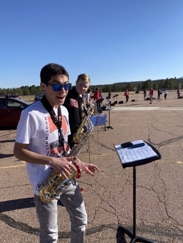 Senior Samuel Loyo and Sophomore John Harper pose at Thursday night band practice while preparing to warm up.