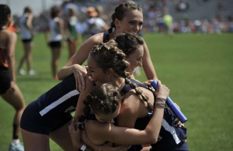 Cross Country runner Bethany Michalak celebrates with her team! Photo taken by Lori Mickalak