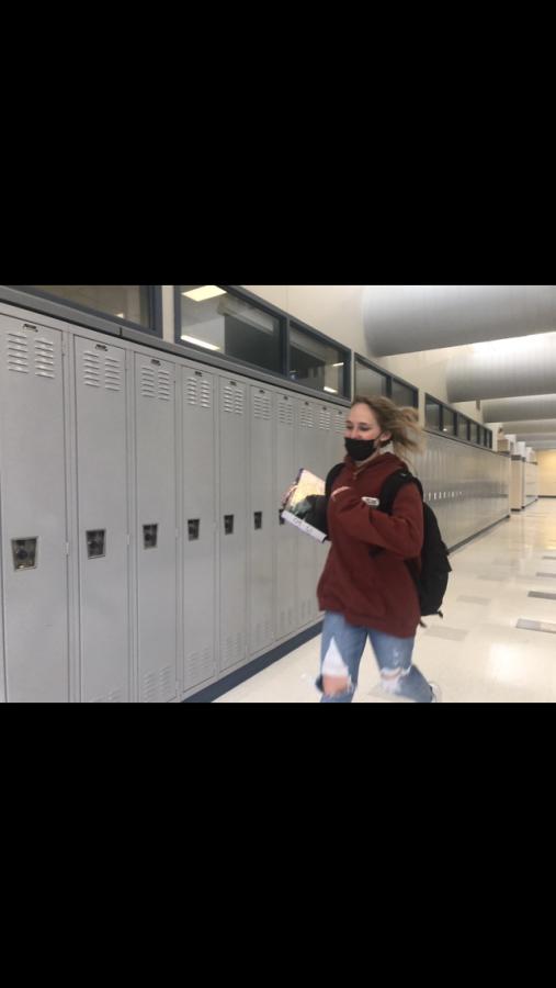 Junior, Ella Mitchler running through the hall to make it to her next class.