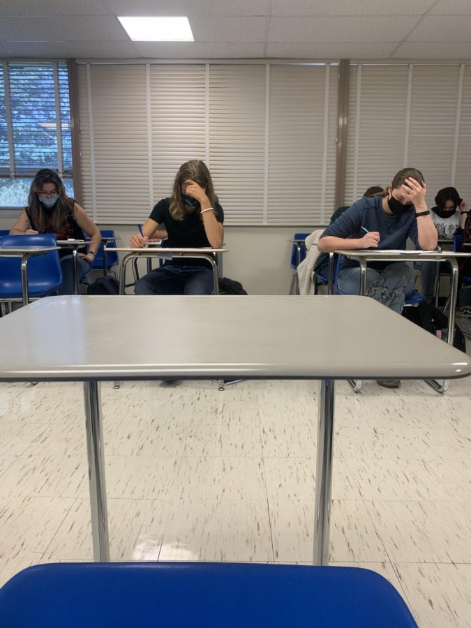 Students hard at work in an in-person learning environment.