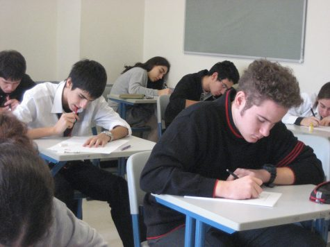 Students taking the SAT. Labeled for reuse by Flicker.